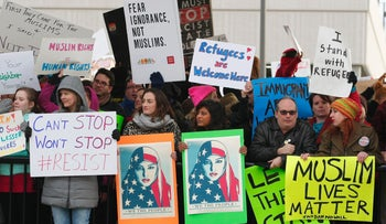 Protesters at Hartsfield–Jackson Atlanta International Airport denounce U.S. President Donald Trump's ban on refugees and travelers from seven Muslim-majority countries, January 29, 2017