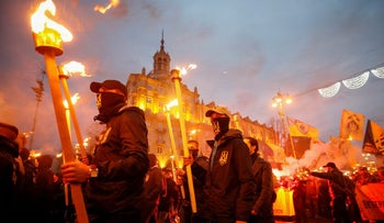 Activists of the Azov civil corp, Svoboda (Freedom), Ukrainian nationalist parties and the far-right radical group Right Sector take part in a rally to mark 'Defender of Ukraine Day', in Kiev, Ukraine. October 14, 2017