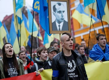 Activists of the Svoboda (Freedom) Ukrainian nationalist party rally to mark the 71st anniversary of the Ukrainian Insurgent Army (UPA). The portrait is of UPA leader Stepan Bandera. Kiev, October 14, 2013