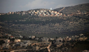 The Palestinian village of Awarta is in the foreground and the Jewish settlement of Etmar on the background, West Bank, January 26, 2017.