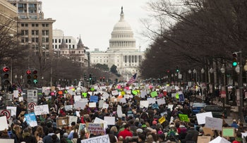 Demonstrators march down Pennsylvania Avenue to protest President Donald Trump's executive order barring the citizens of seven Muslim-majority countries, Washington D.C., January 29. 2017.