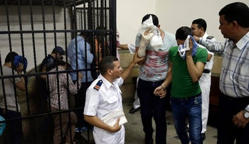 "In this file photo, eight Egyptian men convicted for ""inciting debauchery"" following their appearance in a video of an alleged same-sex wedding party in Cairo, Egypt on November 1, 2014."