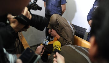 Mohammed Shinawi, charged with politically motivated murder and with attempted murder, in court, Haifa, January 30, 2016.