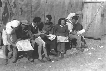 People read the papers in pre-state Israel, 1936.