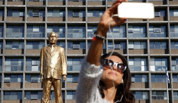 A woman takes a selfie with a statue of Israel's Prime Minister Benjamin Netanyahu, created by Israeli artist Itay Zalait as a political protest against Netanyahu, which was placed without official permission outside Tel Aviv's city hall, Israel December 6, 2016.