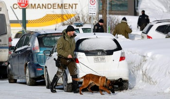 Police officers patrol the perimeter at the scene of a fatal shooting at the Quebec Islamic Cultural Centre in Quebec City, January 30, 2017.