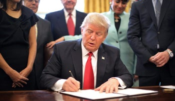 U.S. President Donald Trump signing an executive order January 30, 2017.
