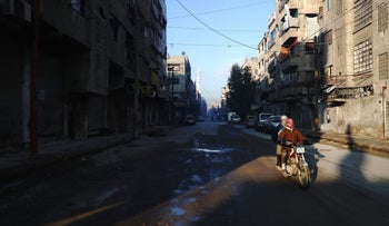 Syrian men drive a motorbike in the rebel-held town of Douma, on the eastern outskirts of Damascus, January 30, 2017.