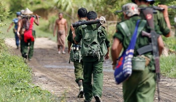 Myanmar soldiers patrol a road in Maungdaw, August 31, 2017.