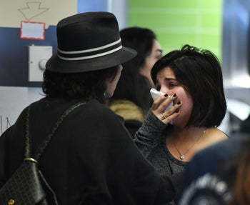 A woman of Iranian descent (R) cries as she waits for a family member after the immigration ban imposed by U.S. President Donald Trump at the Los Angeles International Airport, California on January 30, 2016.