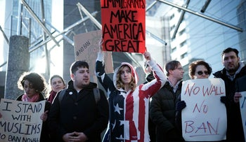 A protest against U.S. President Donald Trump's order temporarily banning immigrants from seven Muslim-majority countries from entering the U.S., outside of the U.S. Embassy in Tokyo, Tuesday, Jan. 31, 2017.