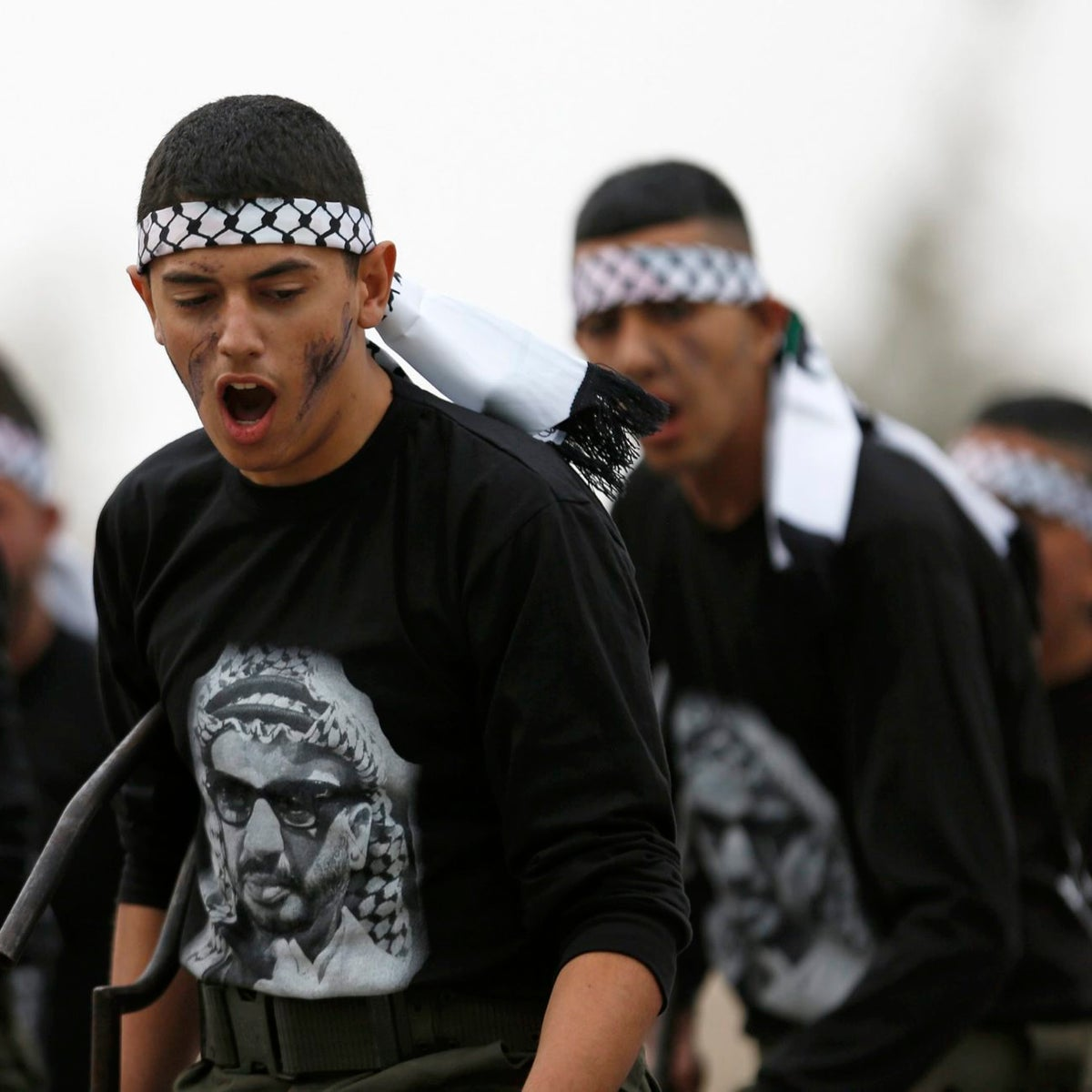 Palestinians take part in a training session at a 3-day youth camp with Palestinian security forces, in the West Bank city of Jericho, Wednesday, Jan. 25, 2017. The participants are wearing t-shirts with an image of the late Palestinian leader, Yasser Arafat.
