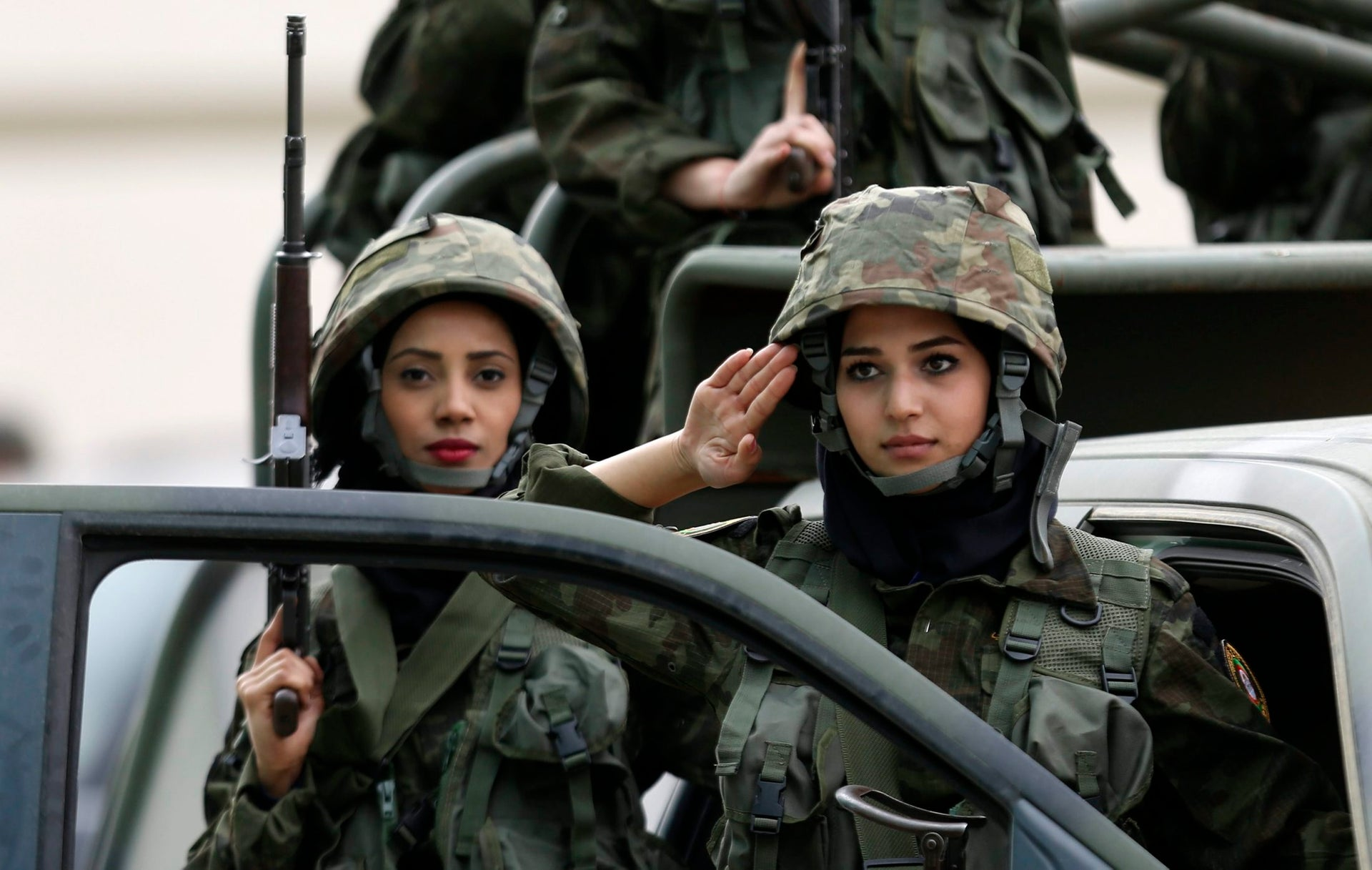 Female members of the Palestinian presidential guard take part in a training session at a youth camp with Palestinian security forces, in the West Bank city of Jericho, Wednesday, Jan. 25, 2017. The participants wear military uniforms and spend 3 days in the military camp.