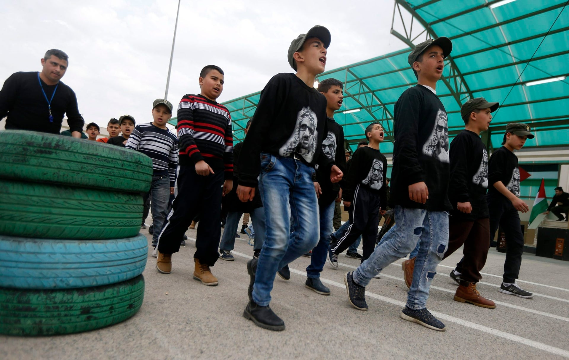Palestinian take part in a training session at a youth camp with Palestinian security forces, in the West Bank city of Jericho, Wednesday, Jan. 25, 2017. The participants spend 3 days in the military camp.