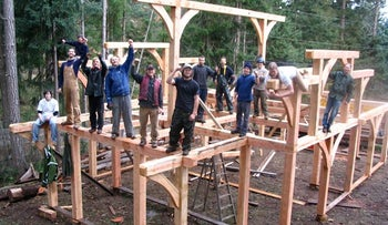Island School students working on a timber building.