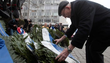 A Holocaust survivor lays a wreath in Thessaloniki, Greece this week on the 74th anniversary of the first transport of Jews from the city to Auschwitz.