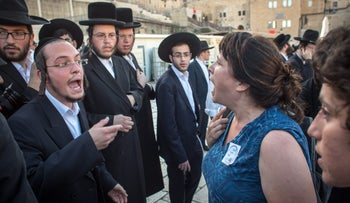 Ultra-Orthodox men argue with Reform worshipers during a mixed prayer service at the Western Wall, in Jerusalem, June 2016.