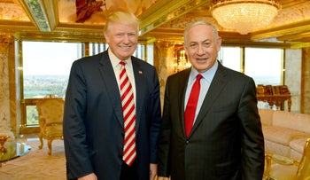 Benjamin Netanyahu, right, stands next to  Donald Trump during their meeting in New York, September 25, 2016.
