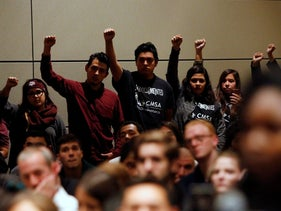 Undocumented Texas A&M students and their supporters protest silently as white nationalist leader Richard Spencer of the National Policy Institute speaks on campus at an event not sanctioned by the school, at Texas A&M University in College Station, Texas, U.S. December 6, 2016.