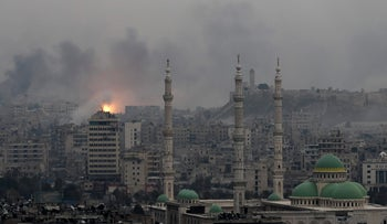 A fireball rises following an airstrike on rebel-held positions in east Aleppo, Syria, December 5, 2016.