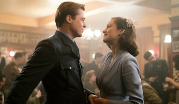 In this image released by Paramount Pictures, Marion Cotillard, right, and Brad Pitt appear in a scene from 'Allied.'