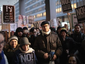 Protesters demonstrate against President Donald Trump outside the Federal Building in Chicago, Illinois, January 31, 2017.