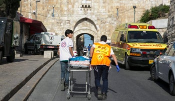Paramedics walk with toward Temple Mount in Jerusalem's Old City after a terror attack took place there, July 14, 2017.