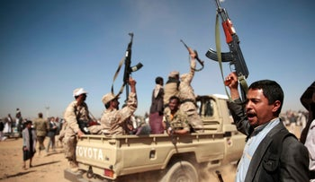 FILE - In this Jan. 3, 2017 file photo, tribesmen loyal to Houthi rebels chant slogans during a gathering aimed at mobilizing more fighters in Sanaa, Yemen.