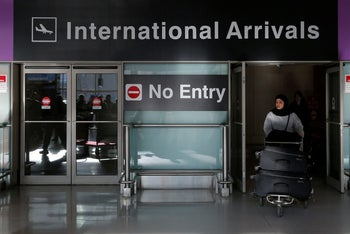 An international traveler arrives at Logan Airport in Boston on January 30, 2017 after U.S. President Donald Trump's executive order travel ban.