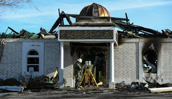 A security official investigates the aftermath of a fire at the Victoria Islamic Center mosque in Victoria, Texas on January 29, 2017.