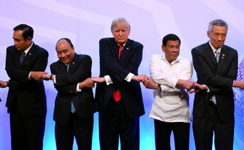 Thailand's Prime Minister Prayut Chan-o-Cha, Vietnam's Prime Minister Nguyen Xuan Phuc, U.S. President Donald Trump, Philippine's President Rodrigo Duterte and Singapore's Prime Minister Lee Hsien Loong pose for a family photo during the ASEAN-US 40th Anniversary commemorative Summit in Manila, Philippines November 13, 2017.