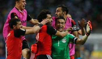Egypt's Essam El-Hadary celebrates with team mates after the game.