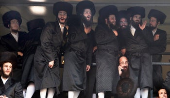 Ultra-Orthodox men wear shtreimels at a wedding party.