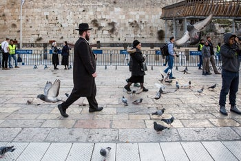 An ultra-Orthodox man walking in front of the Western Wall, February 2017.