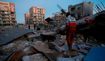 Rescue personnel conduct search and rescue work following a 7.3-magnitude earthquake at Sarpol-e Zahab in Iran's Kermanshah province on November 13, 2017
