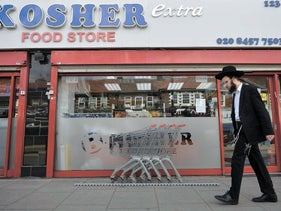 An orthodox Jewish man walks past a shop in Golders Green in north London, May 3, 2016.