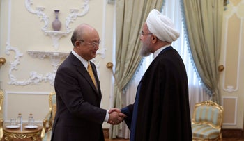 President Hassan Rouhani welcomes Director General of the International Atomic Energy Agency Yukiya Amano for their meeting in Tehran, Sunday, Oct. 29, 2017.