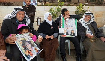 Qusai al-Amour's family mourning him in Tuqu.