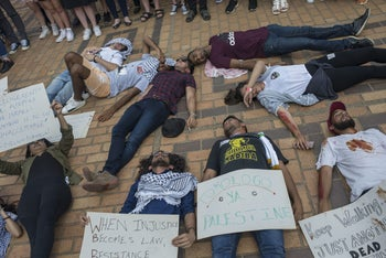 During Israel Apartheid Week at Witwatersrand University, students stage a 'die-in' theater performance simulating the Palestinians' conflict with Israel. Johannesburg, South Africa. March 8, 2017.