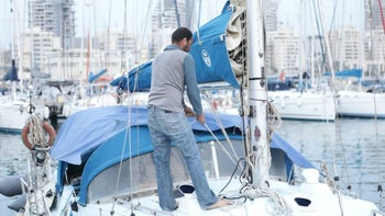 Roy Erez and the boat he lives on in Ashdod Port, January 2017.