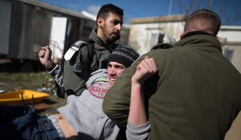 Israeli officers evacuate an Israeli settler from the illegal outpost of Amona. Feb. 2, 2016.