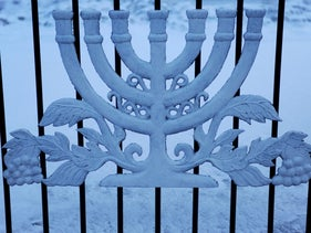 A decoration representing a menorah, a seven-branched candelabra, is pictured on a fence in Birobidjan City, administrative center of the Jewish autonomous region, Russia.