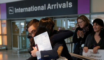 Originally turned away from a U.S.-bound flight following Trump's travel ban, an Iranian student is greeted by his sister after clearing immigration, Boston, Massachusetts, February 3, 2017.