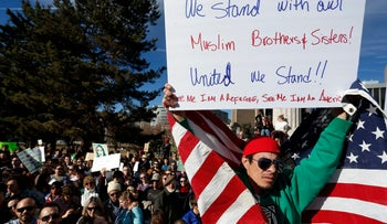 Thousands gather at Denver's City Center Park for a rally in support of the Muslim community and to protest President Donald Trump's executive order to temporarily ban refugees from seven mostly Muslim countries, in Denver, Saturday, Feb. 4, 2017.