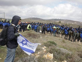 Police forces at the illegal West Bank outpost of Amona, February 1, 2017.
