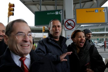 Iraqi immigrant Hameed Darwish (C) walks out of J.F.K. Airport's Terminal 4 with Congressman Jerrold Nadler (L) and Congresswoman Nydia Velazquez (R) after being released, January 28, 2017.