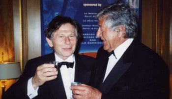 Producer Gene Gutowski, right, talks with film director Roman Polanski in Cannes, France, May 2002.