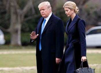 President Donald Trump, accompanied by his daughter Ivanka, waves as they walk to board Marine One on the South Lawn of the White House in Washington, Feb. 1, 2017.