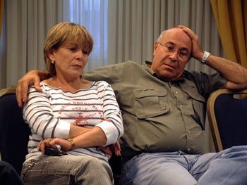 The parents of Sharon Ben-Shalom and Doron Sueri pictured in May 2004 at a support group for bereaved parents.