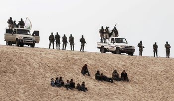 Hamas fighters in Gaza attend a memorial for Mohammed Alzoari, a Tunisian engineer killed in Tunisia, January 31, 2017.